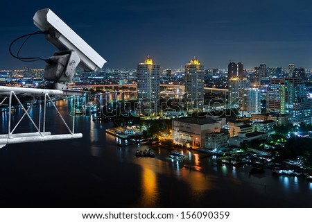 Security cameras monitor the movement of the top of the building, Aerial view of Bangkok along Chaophraya River. - stock photo