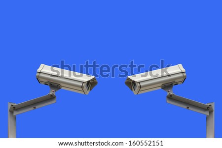 security cameras on blue with room for type