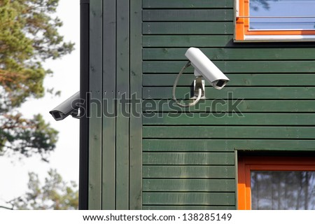 security cameras on the building walls - stock photo