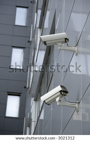 Security cams attached on corner of the building - stock photo
