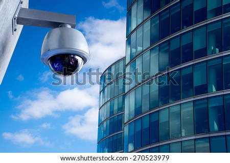 Security CCTV camera in office building - stock photo
