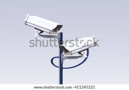 Security CCTV camera on gray background