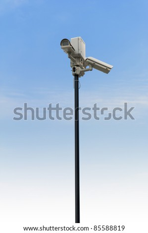 Security cctv cameras in front of blue sky - stock photo