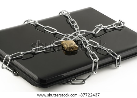 security concept lap top wrapped in chains and padlocked - stock photo
