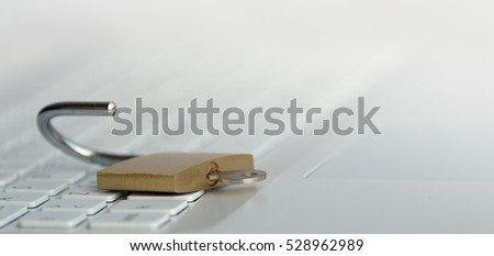 Security concept,open padlock on white keyboard.Computer being protected from online cybercrime and hacking