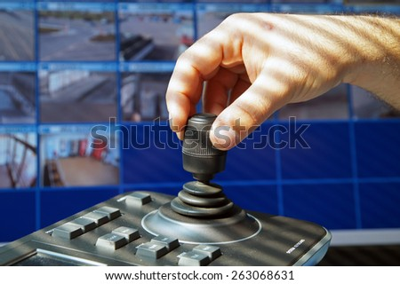 security control room with keyboard and joystick to remove and control cameras - stock photo