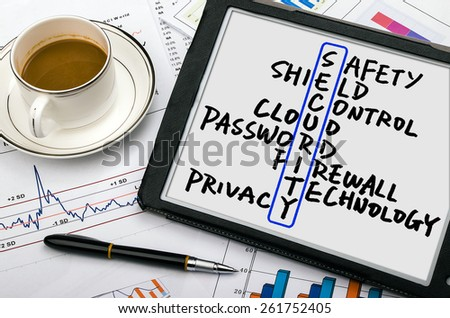 security crossword concept handwritten on tablet pc - stock photo