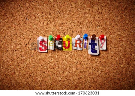Security  - Cut out letters pinned on a notice board.