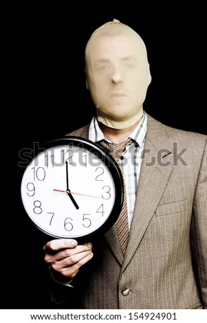 Security Deadline Image Of A Robber Or Burglar Doing Time While Holding Clock At Dusk In A Curfew Depiction Of Night Time Being Prime Time For Crime Time - stock photo