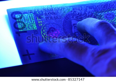 Security features on a 100 pln (polish) banknote - stock photo
