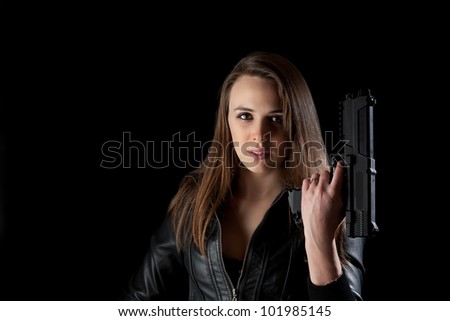 Security girl with gun. Isolated on black - stock photo