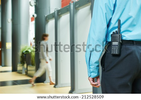 security guard controlling indoor entrance gate  - stock photo