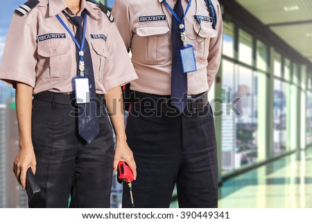 Security guard on modern office building - stock photo