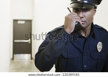 Security guard using a walkie-talkie - stock photo