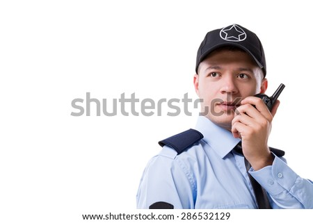 Security guard with walkie-talkie on white background.