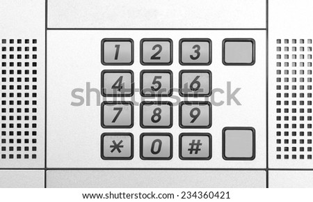 Security intercom number keypad at apartment door - stock photo