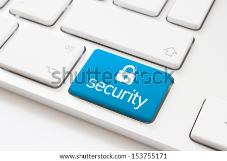 Security key with lock icon on a white keyboard - stock photo