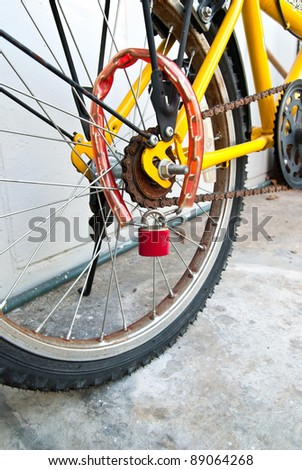 Security lock blocking the bicycle wheel - stock photo