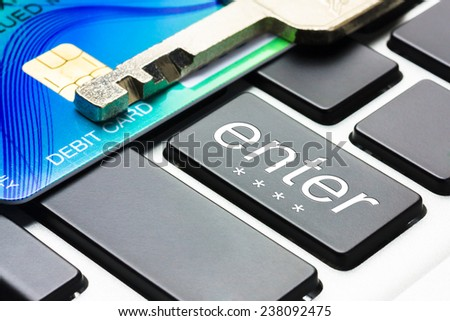 Security lock on credit card with computer keyboard.