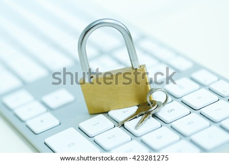 Security lock on white computer keyboard - computer security breach concept - stock photo