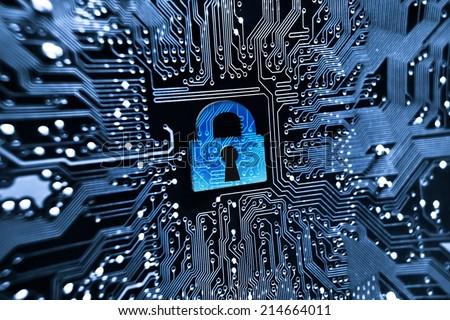 security lock symbol on computer circuit board - stock photo