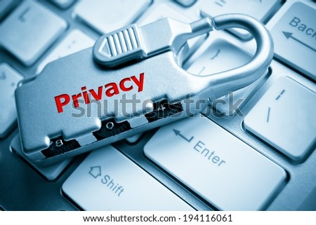 Security lock with privacy message  on white computer keyboard - information privacy concept - stock photo