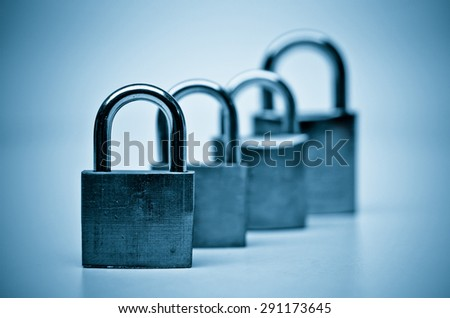 security locks with blue tone - Tough security for computer system - stock photo