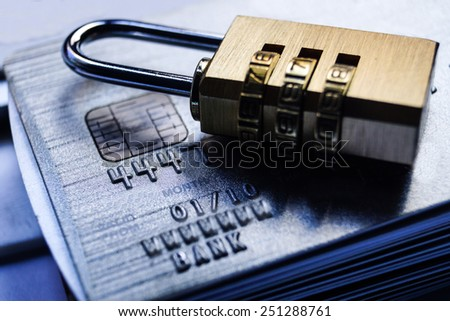 Security locks with password on piles of credit cards / Credit card data encryption concept - stock photo