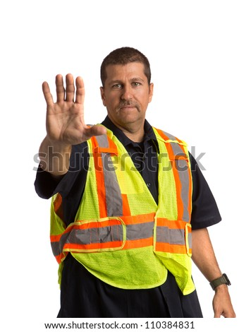 Security Officer Wearing Safety Vest Hand Gesture Directing Traffic on Isolated Background - stock photo