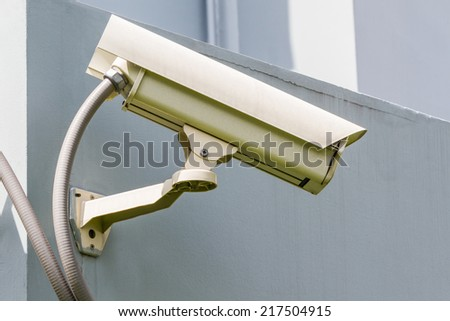 Security or cctv camera on wall background.    - stock photo