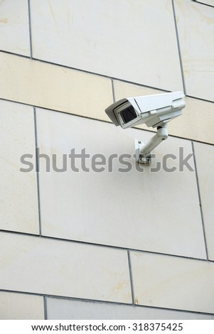 security or surveillance camera on building exterior