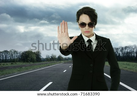 Security service officer stopping traffic on roadway - stock photo