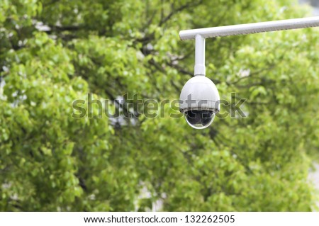 Security surveillance camera in the park - stock photo