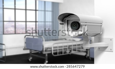 Security surveillance camera on wall in a hospital room - stock photo