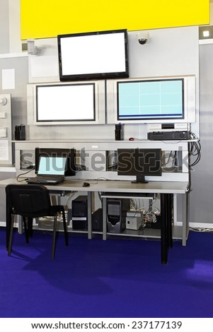 Security surveillance center with monitors and screens