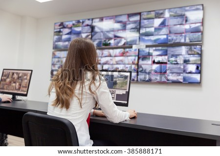 Security system operator - stock photo