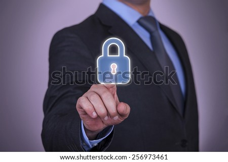 Security Touch Screen Finger Pointing to Padlock Icon - stock photo