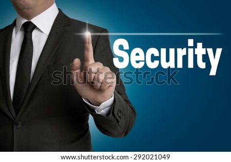 Security touch screen is operated by businessman. - stock photo