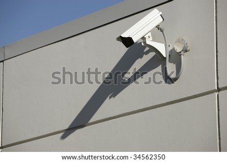 security video camera mounted outdoors on a wall