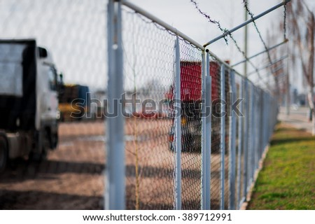 Security with a barbed wire fence - stock photo