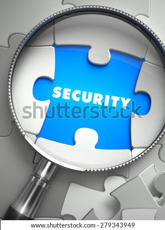 Security - Word on the Place of Missing Puzzle Piece through Magnifier. Selective Focus. - stock photo