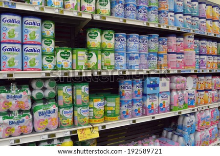 SEDAN, FRANCE - JULY 23:  Market aisle filled with powdered Baby Milk Formula a commercial baby food in a Geant Casino hypermarket on july 23 2013 Sedan,  France - stock photo
