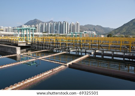 Sedimentation tanks in a sewage treatment plant - stock photo