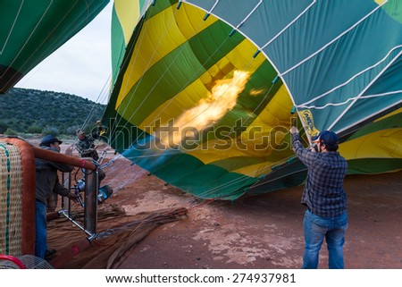 Sedona, Arizona - April 12 : Crew members heating up the balloon and checking for safety, April 12 2015 in Sedona, Arizona.