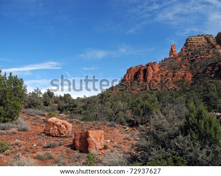 Sedona, Arizona is one of the most beautiful places I have seen, with its red rock cliffs and mesas dotted with stands of brush and greenery. - stock photo