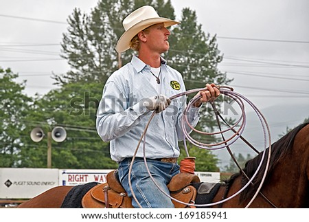 SEDRO WOOLLEY, WA/USA - JULY 3, 2010: This cowboy participates at the annual 4th of July rodeo in Sedro Woolley, Wa. one of the longest running rodeos in the state. - stock photo