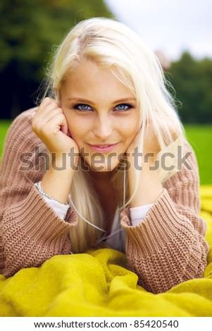 Seductive beauty in park - stock photo