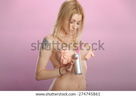 Seductive blond and beverage can - stock photo