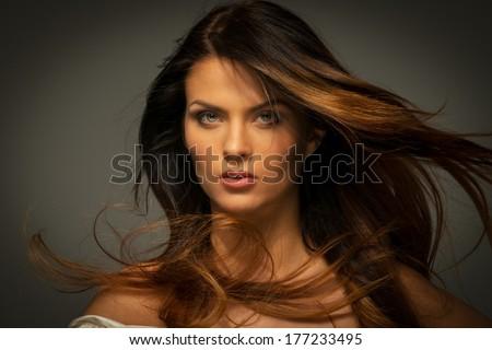 Seductive fatal brunette woman with long hair  - stock photo