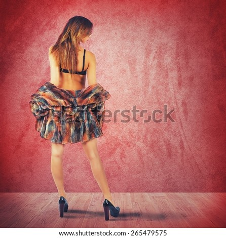 Seductive girl in a sexy red room - stock photo